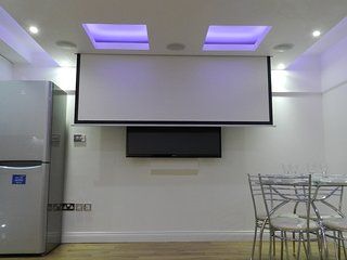 Reception Room - Motorised projection screen retracting into ceiling
