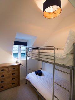 Bunk room with full size adult singles