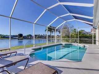 Waterfront home w/ private pool, covered patio, & lake views - close to golf!