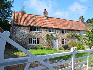 Rose Cottage is a traditional brick and flint country cottage in North Norfolk