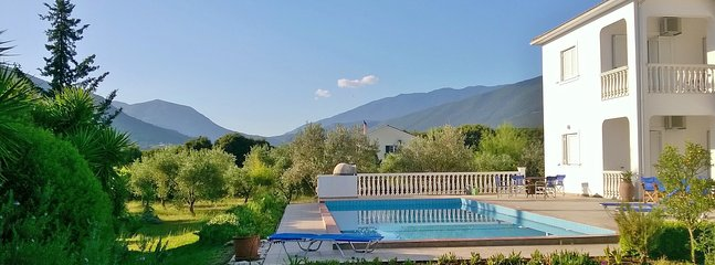 The Walnut Tree villa and pool - view from the garden