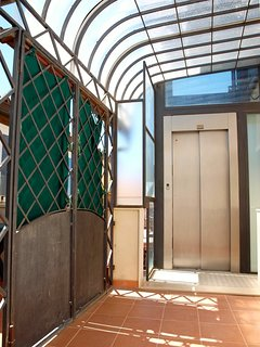 the lift that leads into the third floor of the building and the gate of the veranda