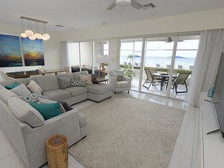 Huge bright living room looking out onto the beach and Caribbean Sea