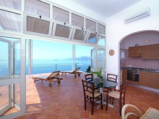 Casa Panoramica - large terrace with stunning view towards Positano and Capri, Praiano