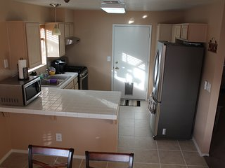 Kitchen and exit to garage.