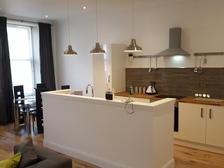 Open plan, lounge, kitchen and dining.