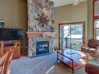 Corner ski-in/ski-out condo with a deck, views & a communal pool and hot tub!
