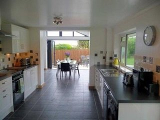 Dining and Garden Room with Bi Fold Doors to 2 sides - opening into the enclosed garden.