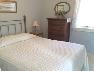 Master bedroom, queen bed, light and airy, with plenty of storage.