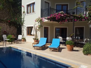 Private pool with an oasis of trees and flowers in the garden