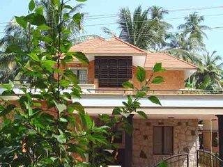 Well furnished property adjoining an ancient Kerala Temple in a serene setting