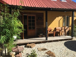 Front verandah of Chalet Hotaru with seating & gas BBQ