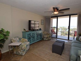Well appointed living room with a queen sleeper and balcony access.