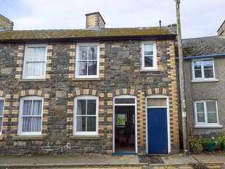 DELFRYN COTTAGE, terraced cottage over three floors, enclosed garden, WiFi, dog