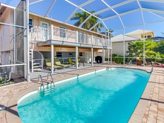 Canal-front home w/ a screened-in pool, a dock, quick access to the Gulf!