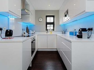 The fully equipped kitchen has a dishwasher, microwave, oven, induction hob and fridge.