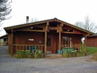 Cosy log cabin in Welsh woodland resort with with pool, gym, restaurant and bar