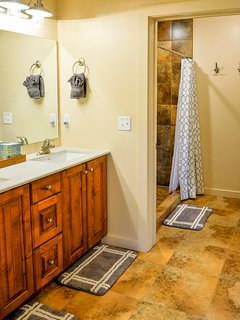 Master bathroom with dual vanities and walk-in shower