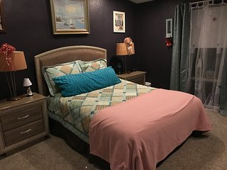 Queen bed, shared 1.5 bathroom. Internet access