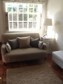 one of the two comfortable sofas in the living room