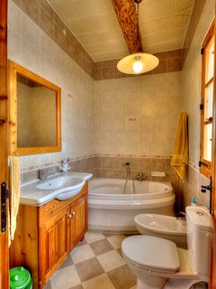 En-suite with corner Bath