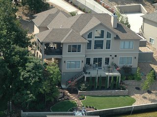 Lakefront Home Sleeps up to 14, stunning view, access to private beach, pool, Lake Ozark