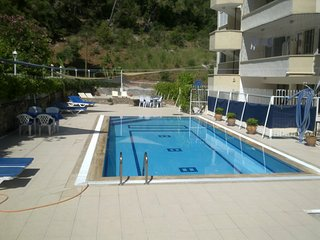 Fully equipped 1 bedroom apartment sleeping 2 guests with shared pool in Fethiye