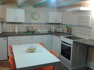 Well equipped kitchen with ample storage and work surface area