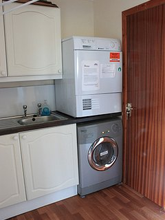 Utility room with washing machine and dryer.