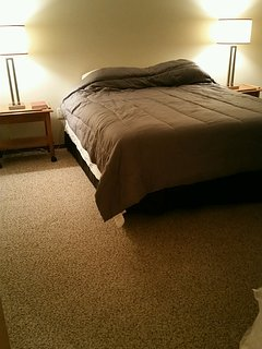 spare bedroom with queen bed and 19' TV/DVD