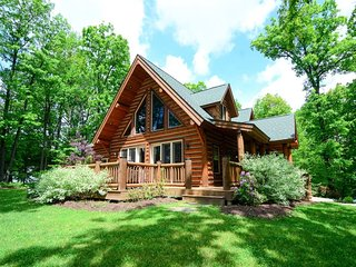 Stake a claim on District Creek! Pristine and sophisticated, this log-style