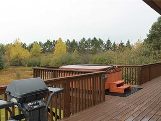 Located at Base of Powderhorn Mtn in the Western Upper Peninsula, A Comfy Duplex with Shared Outdoor Hot Tub & Great View of Ski Hill