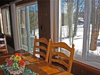 Located at Base of Powderhorn Mtn in the Western Upper Peninsula, A Comfortable Trailside Duplex with Large Brick Fireplace & Access to Lift 1