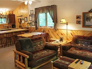 Located at Base of Powderhorn Mtn in the Western Upper Peninsula, A Cheery Condo-Style Home Nestled in the Woods