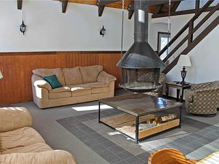 Located at Base of Powderhorn Mtn in the Western Upper Peninsula, A Cozy Home with Great View of Ski Hill & Unique Hanging Fireplace