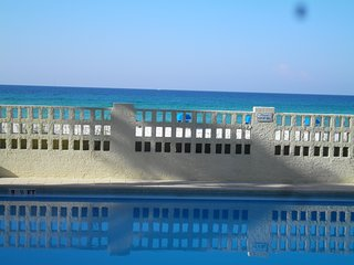 Aqua Villa 103 Beachfront 2BR just feet from the sand!
