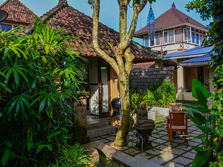 griya Sriwedari standard room with Balcony  in the middle ubud centre