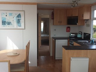 Lovely lake view caravan with private garden on 5* Owners Park