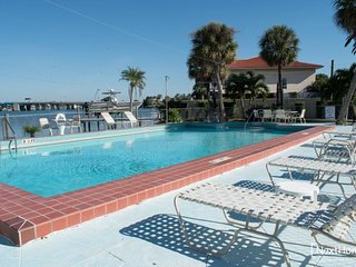 Isles of the Bay | Comfortable Condo with Waterfront pool and fishing dock plus, St. Pete Beach