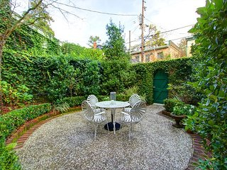 Beautiful Courtyard! Classy, Cozy Garden Level Property!