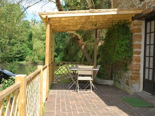 Pergola with outdoor furniture.