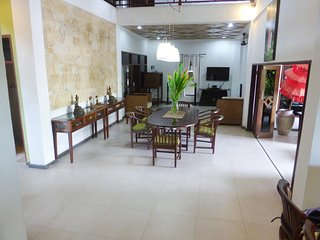 Open dining room, lounge room and kitchen