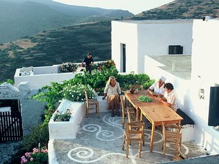 Traditional Cycladic house in a mountain village with sea views