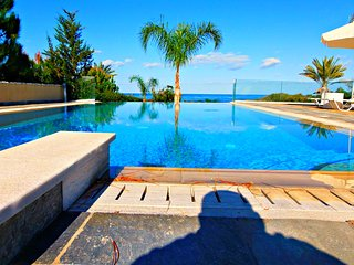 Beach Front Luxury Villa - Large Heated Infinity Pool with Amazing Sea Views