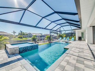 New aviation themed Cape Coral Villa infinity pool at canal bank best of Florida