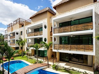 Encanto. . . Brand New, Beautiful Eco-Chic Condo