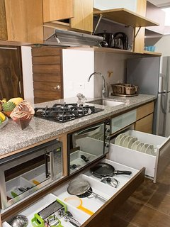 Practical kitchen w/ microave, stove, oven, toaster and almost every dish you'll need to cook