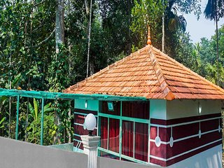 Ponmudi Valley Resort (POOLSIDE COTTAGE)