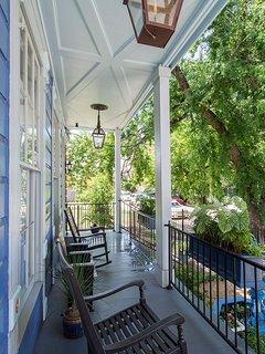The front porch features authentic gas lanterns.