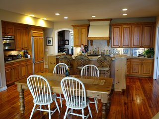 Open floor plan flowing from kitchen to living area